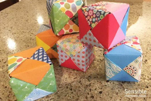 Paper cube building blocks stacked for homeschool architecture lesson