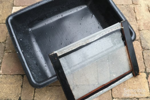 Plastic wash basin and frame with screen for making paper from recycled scraps