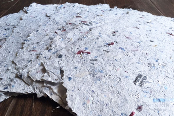 Homemade paper sheets made with recycled wedding memorabilia and paper scraps