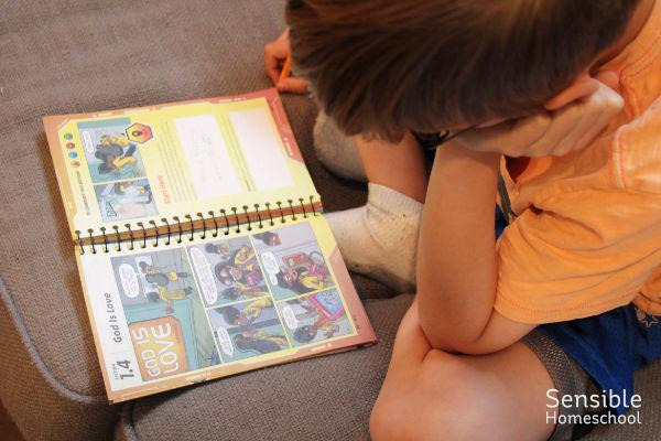 student working on AWANA book