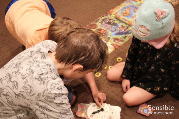 3 kids playing Eye Found It board game