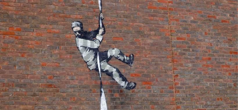 banksy-firma-il-suo-murale-al-carcere-di-reading