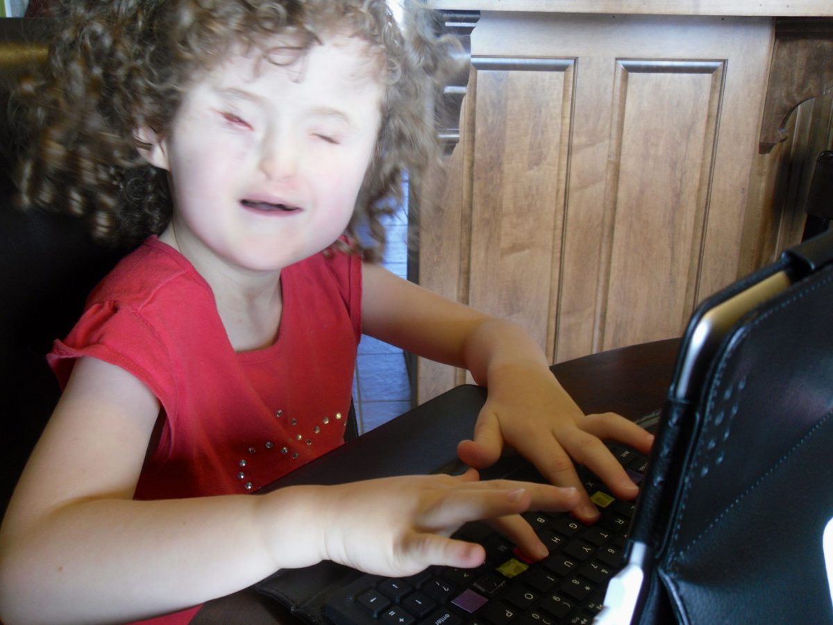 Madilyn using the Apple iPad with VoiceOver and QWERTY keyboard