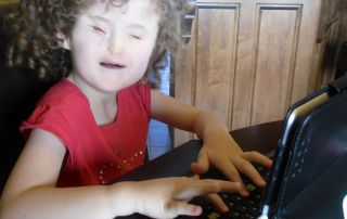Developmental Milestones affect a blind child's independence Madilyn using the Apple iPad with VoiceOver and QWERTY keyboard