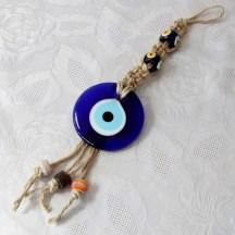 Tresse macramé à suspendre avec œil porte-bonheur et perles de verre
