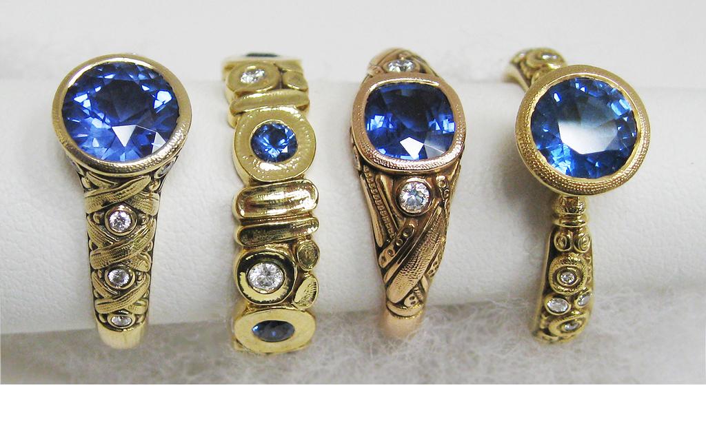Four Sepkus blue sapphire center-stone rings