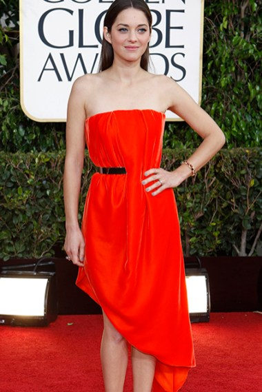 Actress Marion Cotillard poses as she arrives at the 70th annual Golden Globe Awards in Beverly Hills