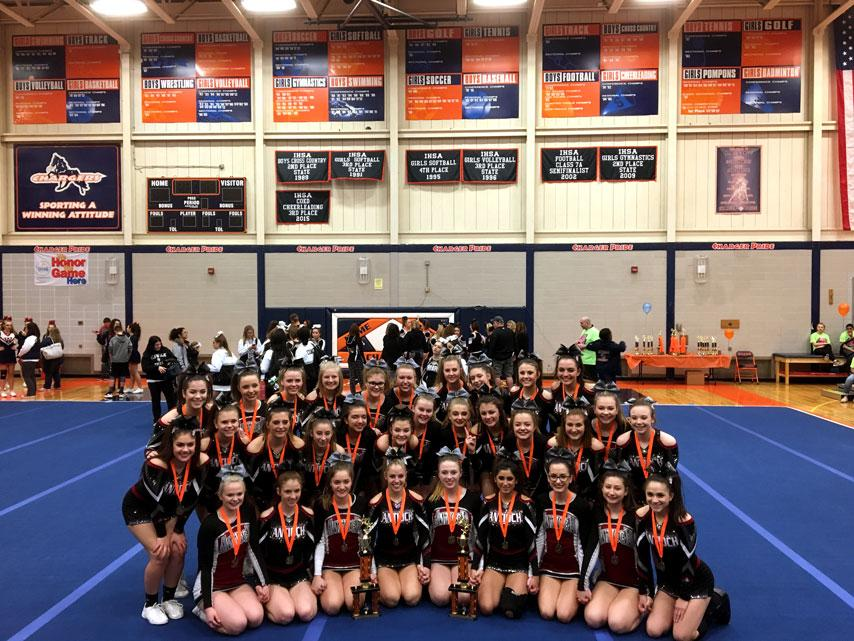 The+JV+and+Varsity+cheer+teams+pose+after+they+both+win+1st+place+in+their+most+recent+competition.