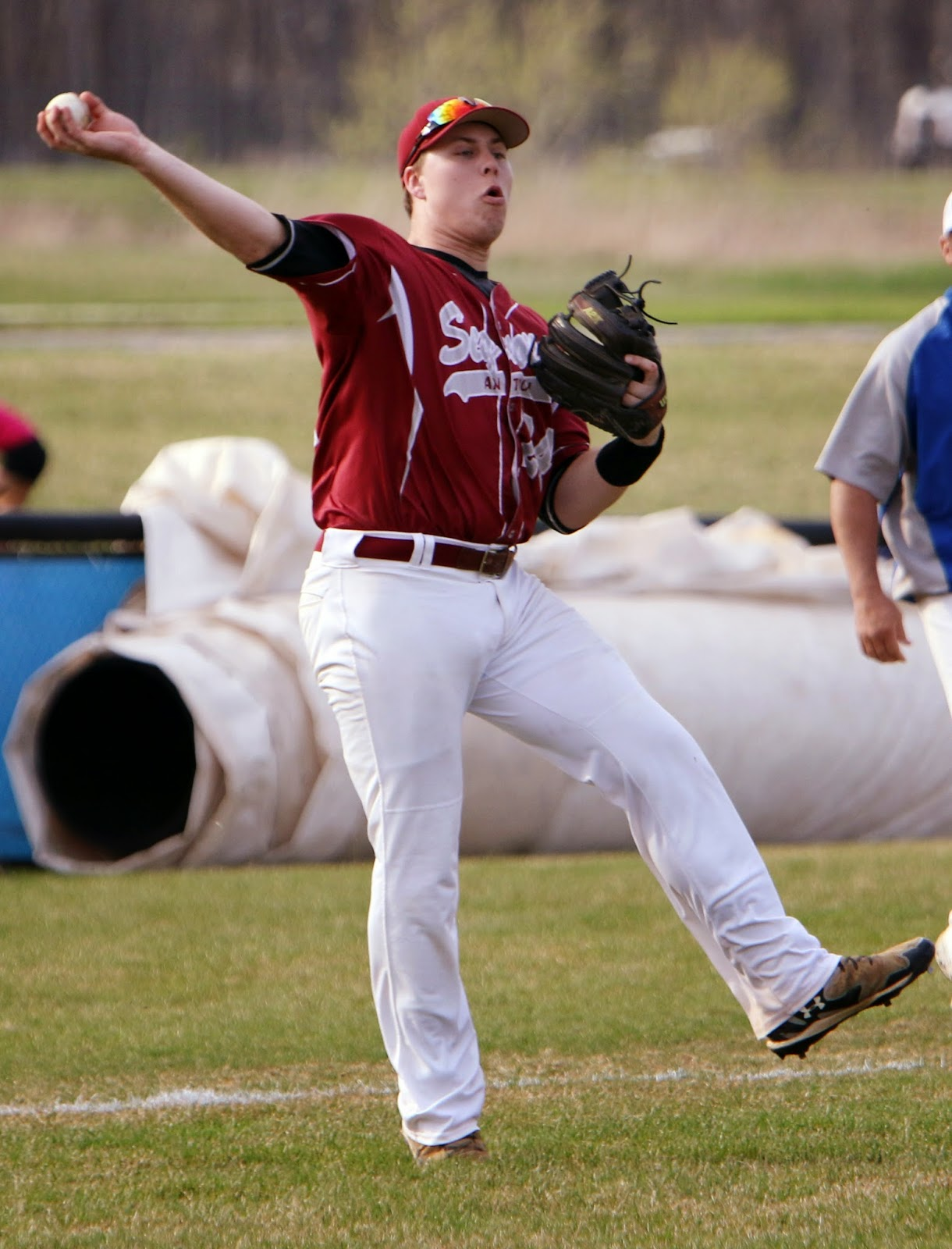 After a hit, Benjamin Gutke throws a ball to first looking to get an out.