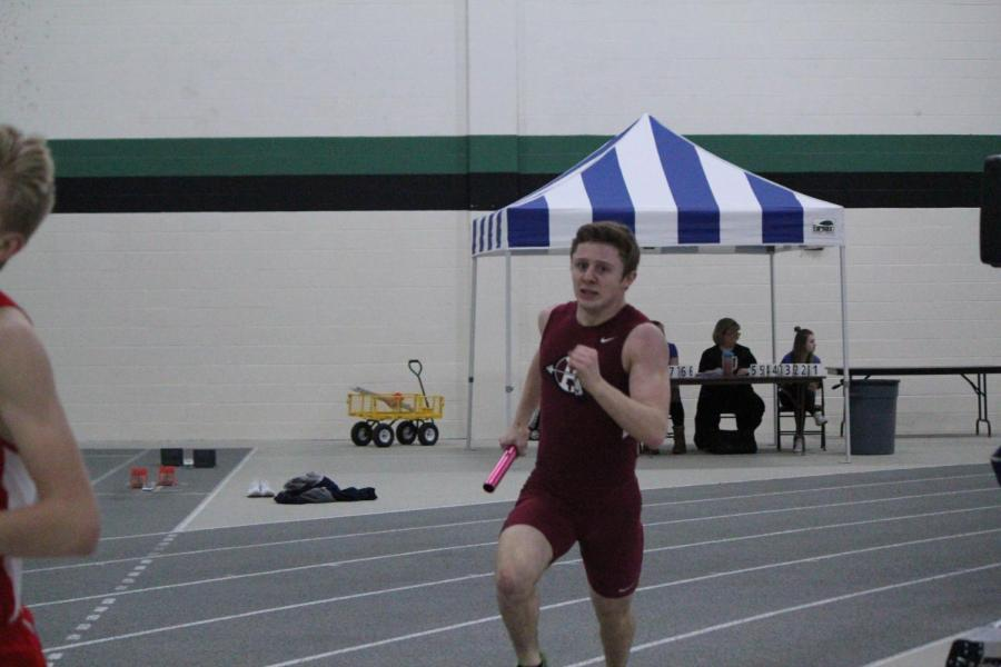 Junior+Mikey+Volkmar+runs+in+the+conference+meet.+