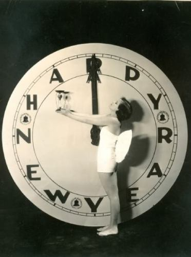 Silent star Barbara Kent marks the time as she ushers in the New Year, 1920's.