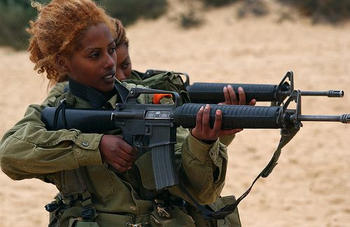 An Ethiopian Jewish soldier takes aim.