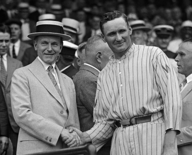 """Calvin Coolidge shakes hands with Walter """"The Big Train"""" Johnson, 1924."""