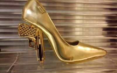 Not sure who makes these golden handgun heels, but I'm going to track them down and buy a pair for Karen.