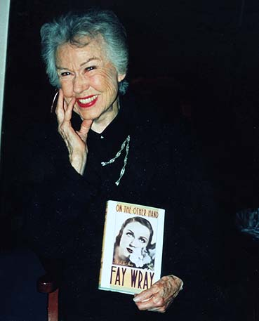 Still lovely, Fay Wray poses with her memoir.