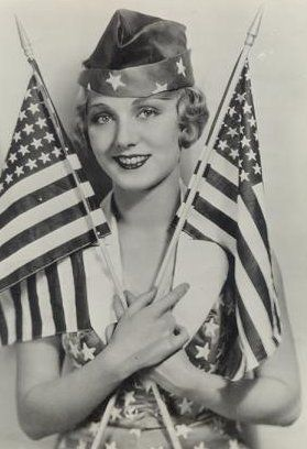 Leilah Hyams waves two flags on July 4.