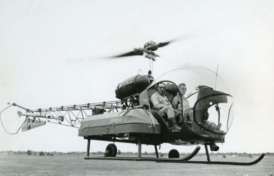"My father in a helicopter, 1956. As you can see, there is a coffin bolted to the chopper. My father never talked about the dead. He did tell me about young soldiers about to go into combat who talked to him about their fears. My father is a good, compassionate man who also counseled non-Jewish soldiers in the absence of a Christian chaplain. ""We were all in it together,"" said my father modestly."