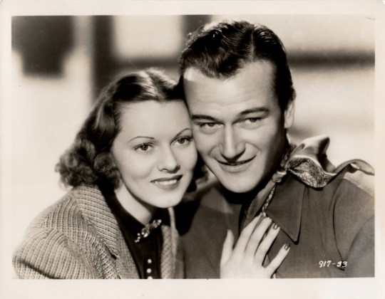 "Publicity photo of Lorna Gray and John Wayne for ""Red River Range."""