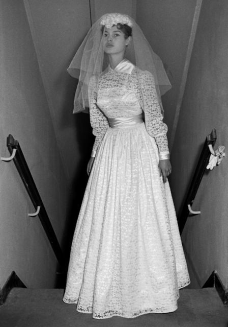 Brigitte Bardot, 18, in a demure wedding gown for her marriage to Roger Vadim. Years and several husbands later, Bardot auctioned off the gown, the proceeds in support of her animal rights foundation.