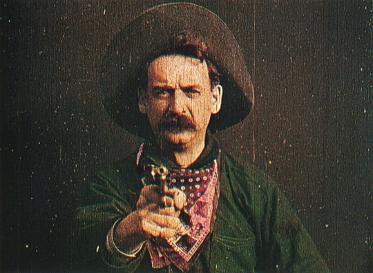 The Great Train Robbery, 1903. Just twelve minutes long, this was first western. Some of the scenes were hand-tinted. Director Edwin S. Porter used new cinematic techniques such as cross-cutting between scenes to advance the story and build suspense.
