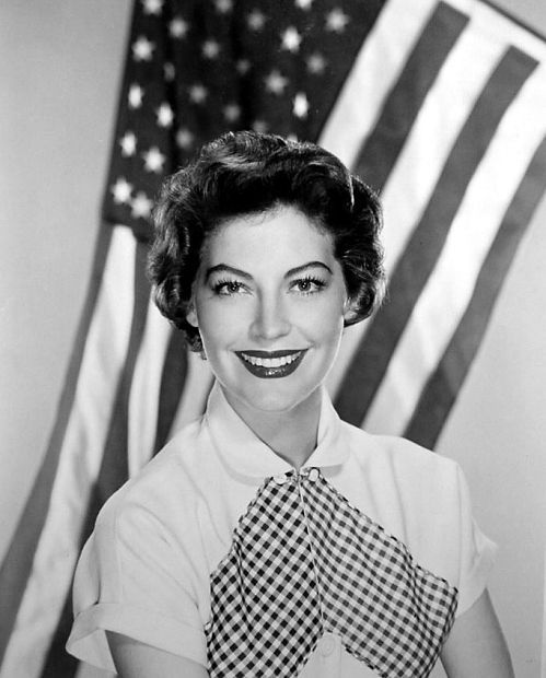 I like this photo of Ava Garden framed against the American flag. At the dawn of her career she did scores of bathing suit, July 4th photos. But this pic, probably from the early 50's, shows a more mature and confident actress as an American icon.