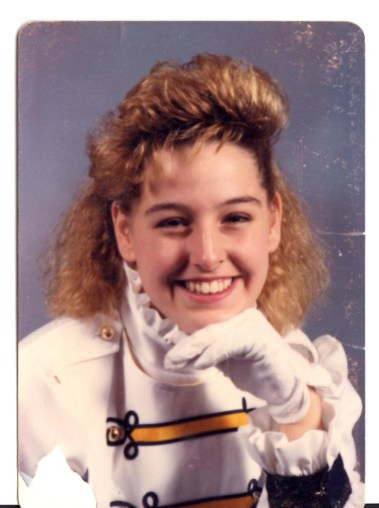 Proof we survived bad 90's hair. This is me 1990?