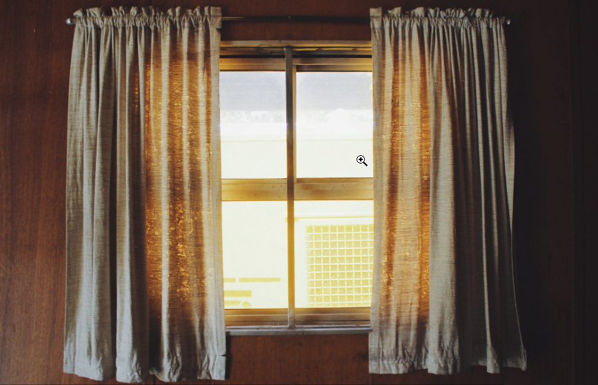 a window with white curtains