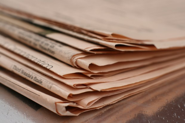 Liquid newsroom paper stack