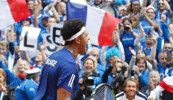 Tsonga wins point to even tie