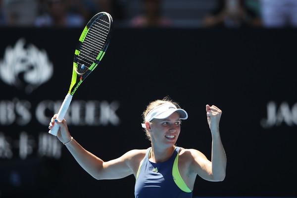 Caroline Wozniacki fights her way to victory