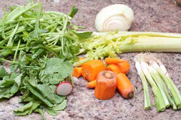 Don't throw away those past their prime or leftover veggies, get more mileage out of them by making your own Vegetable Stock from scratch!