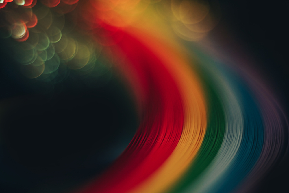 Beautiful abstract rainbow bridge and multi colored space background in the darkness.
