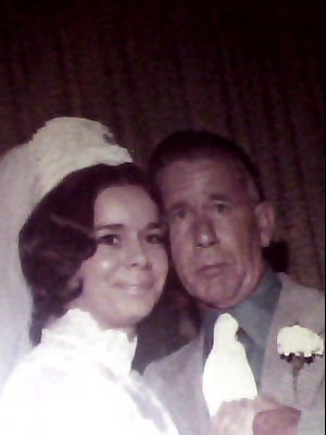 My mom on her wedding day. She is in the picture with her father.