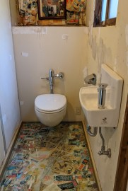 It has a restroom. It doesn't have a door. On purpose.
