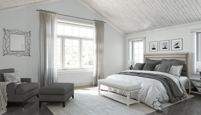 Sherwin Williams Reflection 7661 is a cool gray paint color with a slight blue undertone in this bedroom.