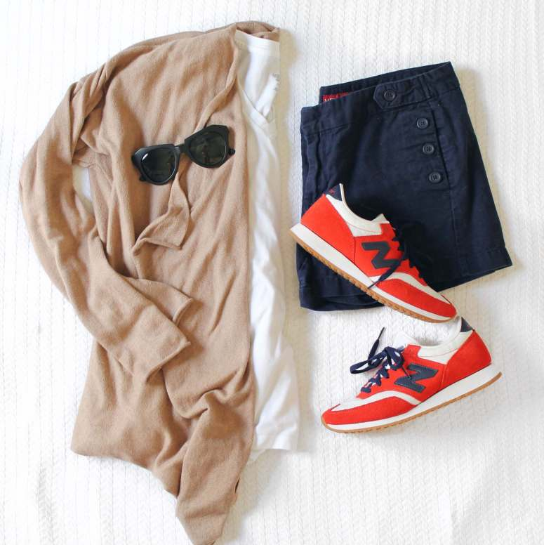 Classic spring look: camel colored cardigan, white tee, navy shorts and sneakers. What to wear with your J.Crew sneakers.