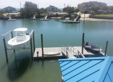 Plummer boatlift and boat storage with retreat floating dock marine construction contractor in the grand stran
