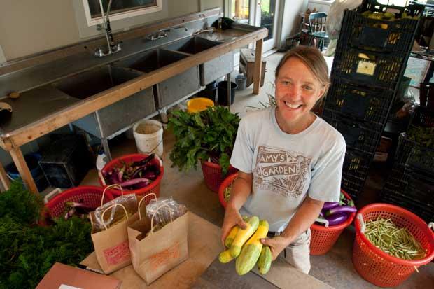 Farmer prepares organic produce for sale.