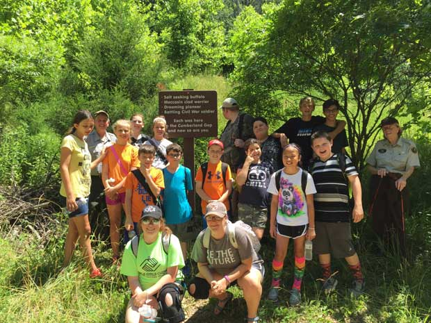 Carter Boys and Girls Club stand in the footsteps of pioneers in Cumberland Gap National Historical Park with Carol Borneman, Chief of Interpretation. NPS Photo.