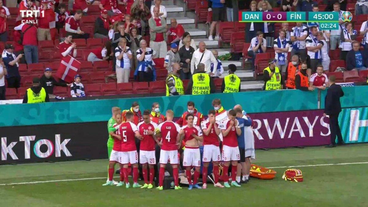 Los jugadores amparan a Eriksen frente a las cámaras mientras es atendido / TV