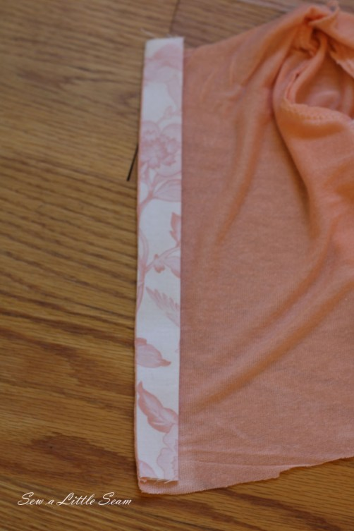 Open up your placket piece and press, and then fold it over along the edge so that you can only see one fabric from each side and press.