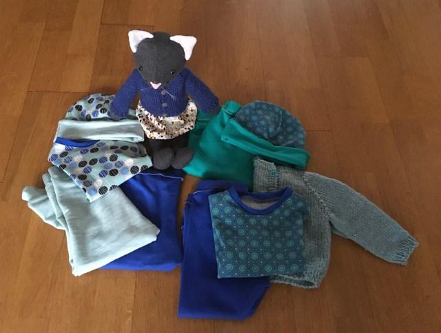 drie zelfgemaakte babykleding setjes