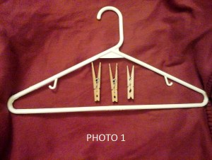 All you need are clothes hangers, clothespins, and a marker or pen (not pictured).