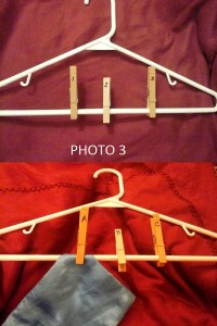 Once you have labeled the clothespins, clip them on the hanger. Finally, attach the cut fabric pieces to their corresponding labeled clothespin by clipping the fabric to the hanger.