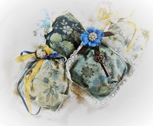 "The last picture is the third set of sachets I made with 5"" squares, lace, silk ribbon, & some metal vintage ornaments."