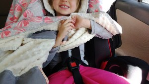 See how she is safely buckled underneath the poncho?