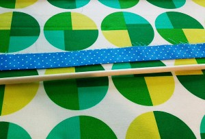 I was pretty sure that if I doubled over the binding strip, the dowel would slip in perfectly to the tube I created.