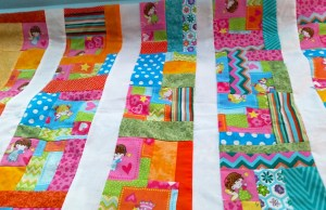 """Improvise"" a cheerful quilt or smaller project & smell the beauty of your creation this spring."
