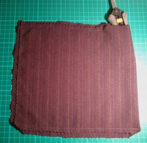 Rectangle of material folded and sewn most of the way around