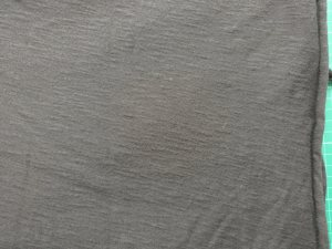 Black T-shirting - with selvage vertical on the right, and grain quite obviously at an angle